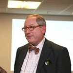Dr Woody Caan